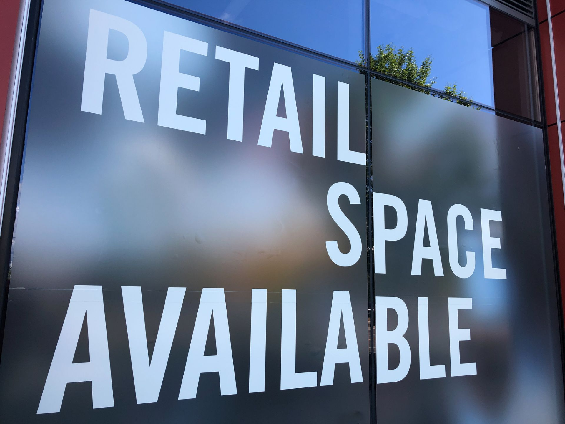 Commercial retail space available sign.