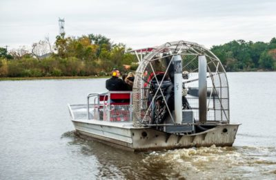 an air boat taking taking tourists on a sightseeing tour